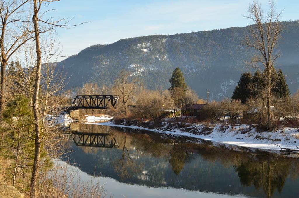 Granby river, train bridge, blue sky